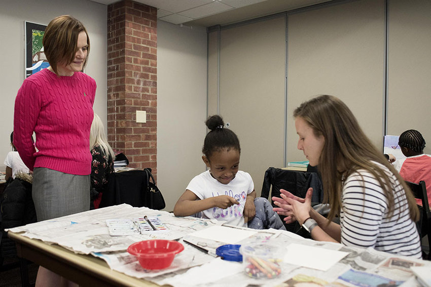 Education Professor Janine Bixler, left, oversees a Mount Saint Mary College teacher candidate during a lesson at the Newburgh Armory Unity Center.