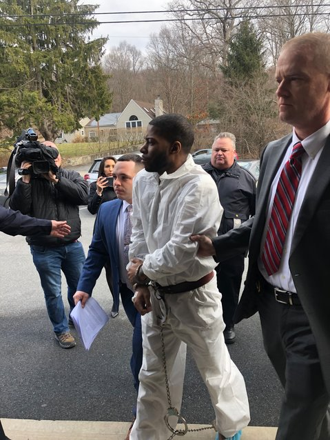 Kaliek Goode-Ford is led into town court for his arraignment on Monday.