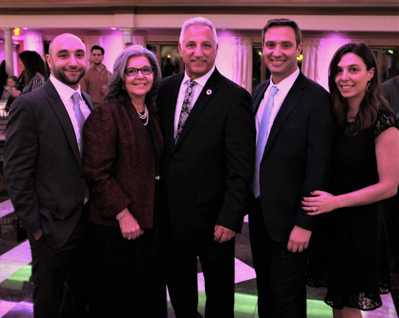 Honoree Richard Gerentine [center]  poses with his family. Pictured (l – r.)  son Austin, his wife Domenica, son Adam and his fiancé Carrie Gurowitz.