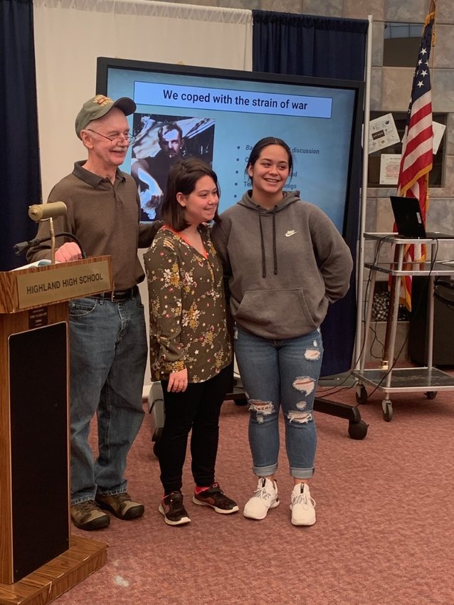 Richard Udden, with his granddaughters Jasmine and Arianna, during his visit to Highland High School.
