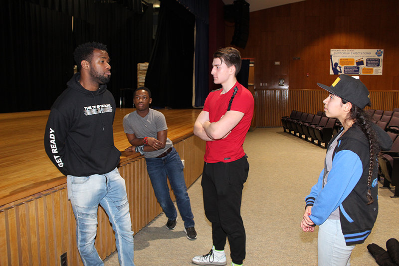 Highland High School students converse with Hamilton star Chaundre Hall-Broomfield after his presentation. The actor gave the students advice on how to be successful as an actor in the professional theatre world. From left, Chaundre Hall-Broomfield, Wilfred Jones, Jr., Chris Bell, and Brianna Acosta.