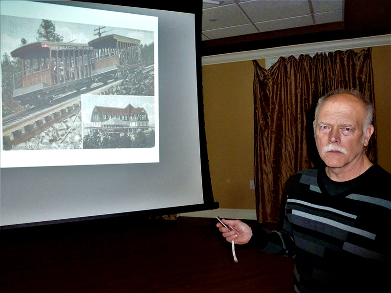 Speaking at the February Program of the Town of Lloyd Historical Preservation Society, John Duda draws his audience's attention to a slide showing an inclined railway in the late 19th or early 20th century.