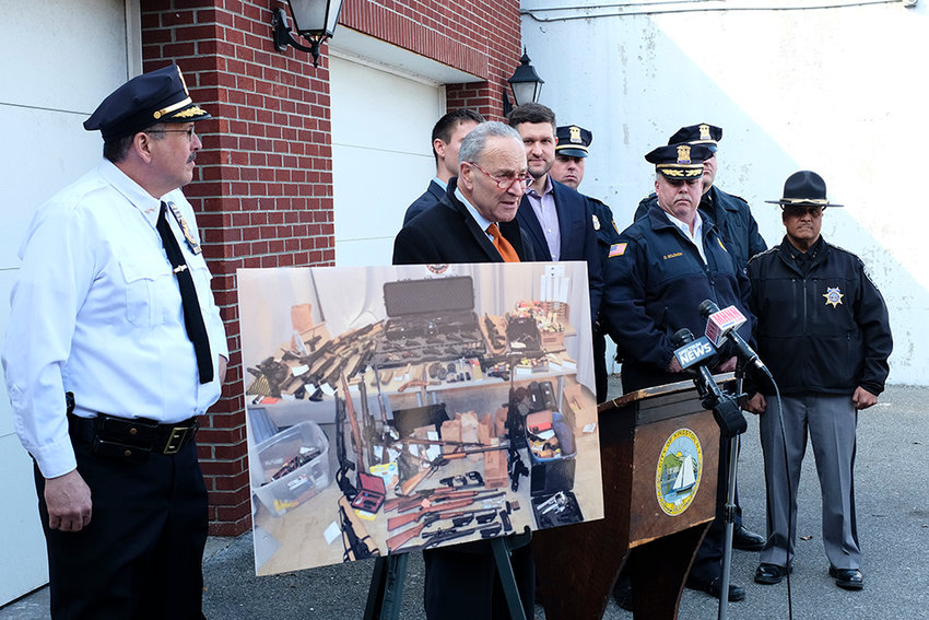 Senator Chuck Schumer[center] held a press conference in Kingston surrounded by local and county law enforcement officers and elected officials to push for getting Ghost Guns off the streets in the Hudson Valley. A picture shows a recent raid that recovered numerous types of these weapons from an individual in Ulster County.