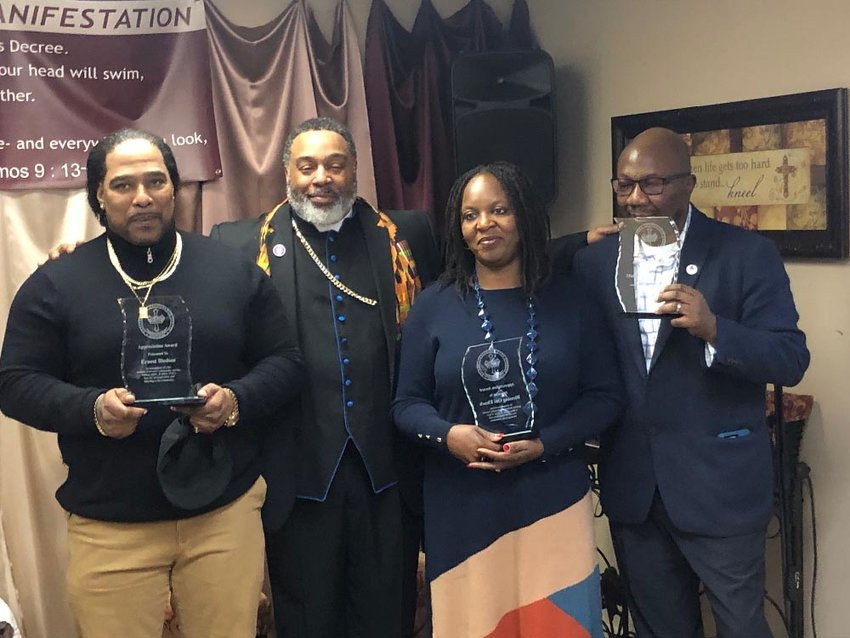 Bishop Troy Johnson (second from left) with honorees: (l - r.) Barber E, Blessing and Mathias Oni-Eseleh of Taconic Innovatons.