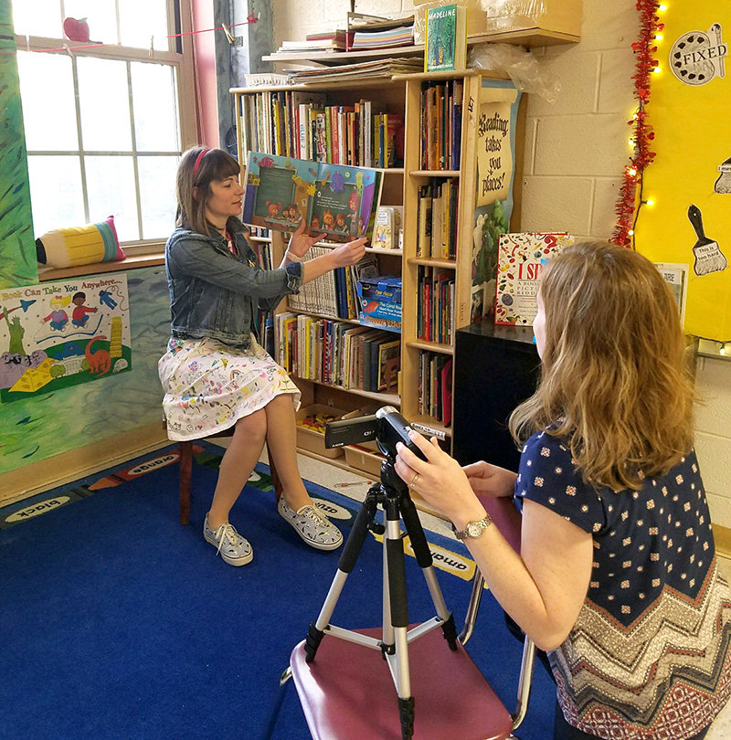 PBE Read-aloud Tara Tuttle and Mrs Butler film a reading session.