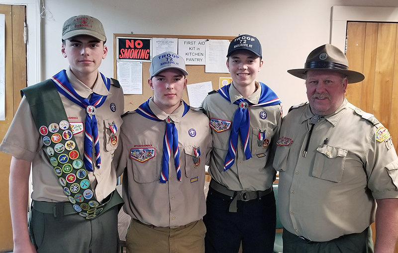 Marlboro Boy Scout Troop 72, under the leadership of Scoutmaster Kurt Borchert (right) recently hosted a Court of Honor to acknowledge Scouts (from left) Avery Albright, Eric Borchert and Max Borchert for having reached the rank of Eagle Scout. The three boys' Eagle Scout project involved a combined 709 volunteer hours. Albright's project enhanced the property at Union Church in Balmville, Eric Borchert renovated portions of the Parish Hall at Christ Episcopal Church in Marlboro and Max Borchert installed 24 environmental information signs around the pond at Cluett Schantz Park in Milton. With the advancement of these three Scouts, Troop 72 has celebrated nine Eagle Scouts in the past two years.