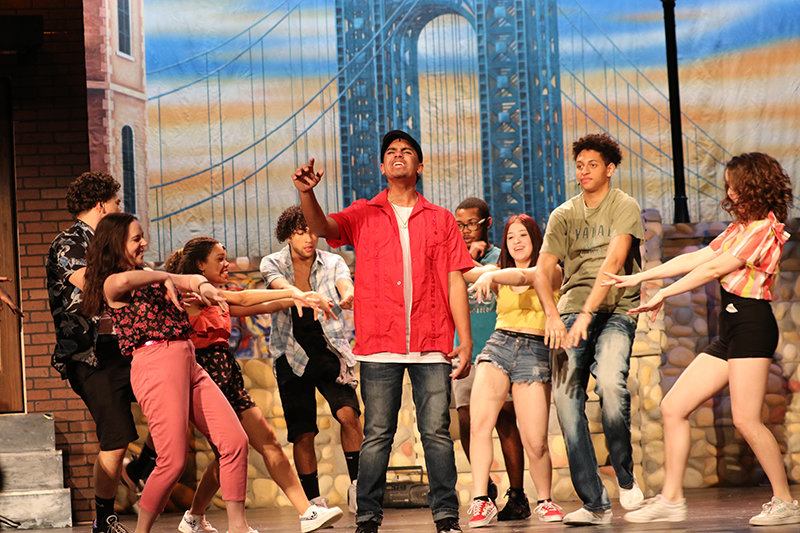 Sam Garcia and dance chorus.
