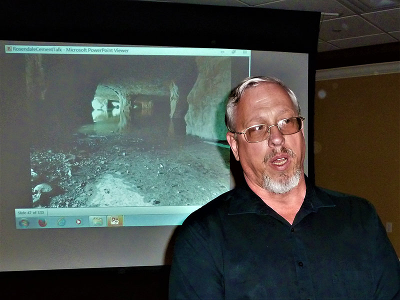 Professor Steven Schimmrich, in front of a slide showing the interior of a Rosendale cement mine, as he speaks on The Geology and History of Rosendale Cement at the March program of the Town of Lloyd Historical Preservation Society.
