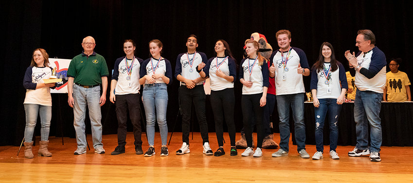 """Pine Bush High School's """"Longshot Solution"""" Division 3 team wins first place and is pictured with Jeff Carter of NYSOMA (second from left). Left to right: Bobbi Walter, Jeff Carter of NYSOMA, Connor Hanington, Rebecca Magnetico, Adam Blumrath, Abigail Cassese, Deanna Lindau, Dylan Cline-Larsen, Ellen Schoenberg, and Gary Manheim."""