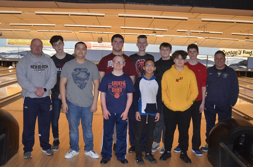 The Newburgh Free Academy bowling team, coached by Jim Horton, left, and Matt Iorlano, right was scheduled to compete at the New York State Public High School Athletic Association championships on March 15 in Syracuse to complete the program's first season. After initially postponing the contest indefinitely, the NYSPHSAA canceled all winter championships on March 23.