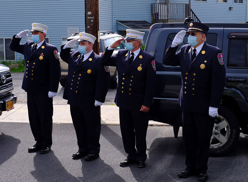 Members of the Highland Fire Department salute those who have been lost in U.S. wars.