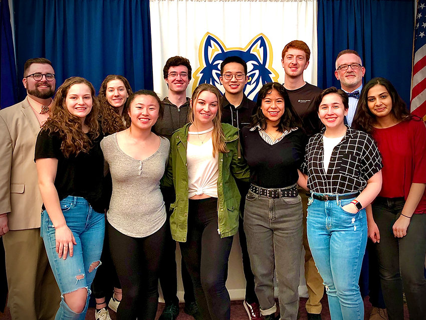"""Each year, HHS recognizes the achievements of the Top Ten students. The Class of 2020's high-achieving soon-to-be graduates include (pictured from the left of back row with Assistant Principal Ryan Judge and Principal William Zimmer on right) Ava Rosen, Quinn Schneider, Salutatorian Minh Tran, Benjamin """"Benito"""" Vargas. Front row from left: Zoe Munson, Eileen Dong, Emily Ramsay, Isabela Cuya, Isabella Fiorese, and Valedictorian Ishani Bansal."""