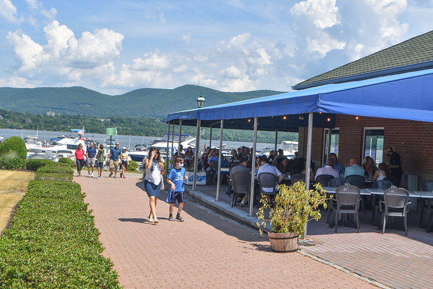 Diners enjoy a late lunch at the Newburgh waterfront on Saturday afternoon.