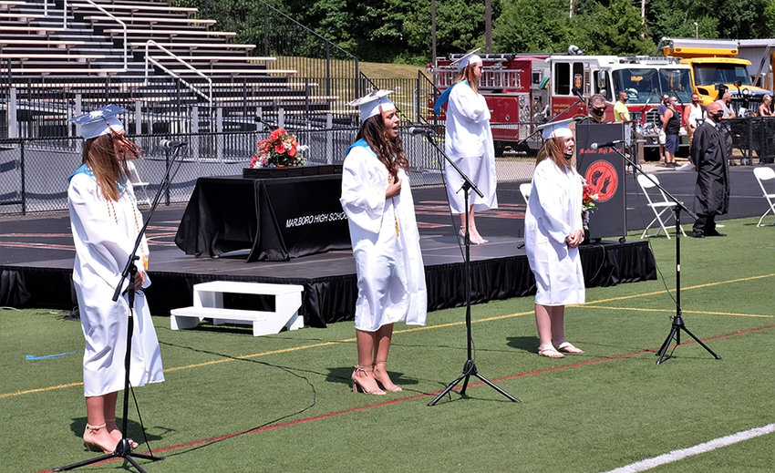 The National Anthem was sung (l-r) by Megan Bach, Emily Eichler and Daniela LoPiccolo with Senior Class President Erin Lofaro on the stage.