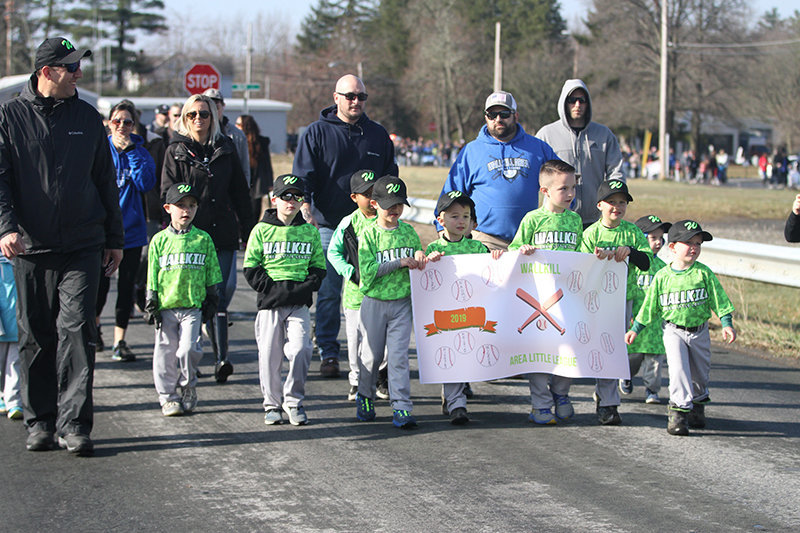 Wallkill Area Little League T-ballers march during the Opening Day parade in 2019. The Wallkill Area Little League last week announced it is canceling its summer camp. It had already canceled its season on May 29.