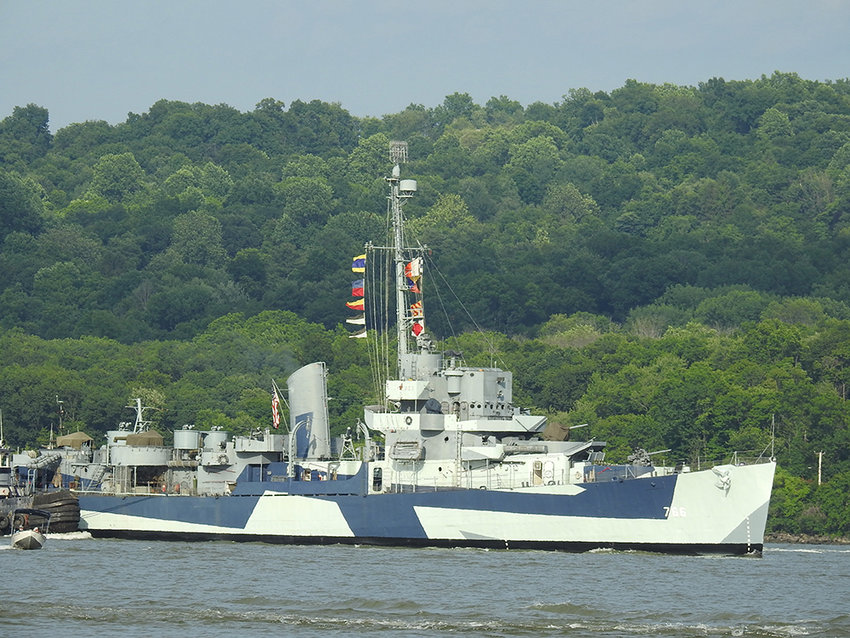 The USS Slater passes under the Newburgh-Beacon Bridge at 6:30 p.m.