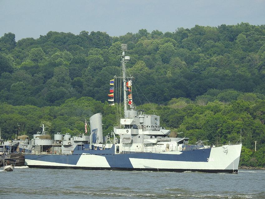The USS Slater passes under the Newburgh-Beacon Bridge at 6:30 p.m.