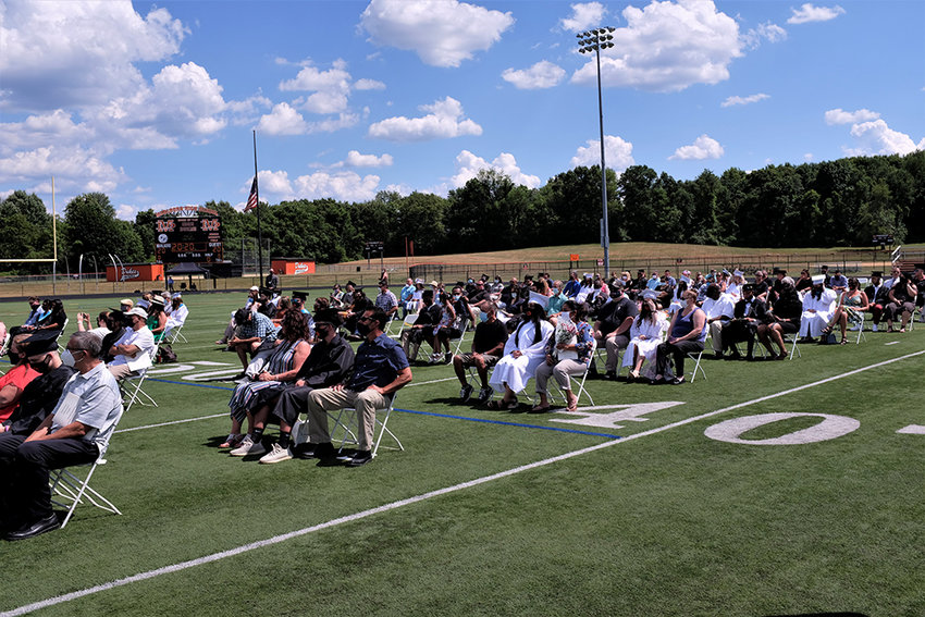 In accordance with state regulations, families and graduates were spread out across the football field for the 84th Marlboro Commencement Ceremony held June 26.