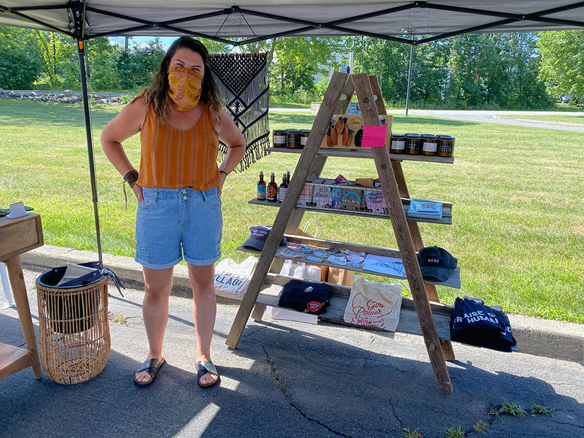 Kateigh Jamieson, owner of Astoria Hudson,  stands with some of her merchandise.