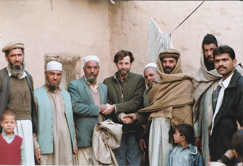 Andrew Penny (c) greeted by Afghan elders.