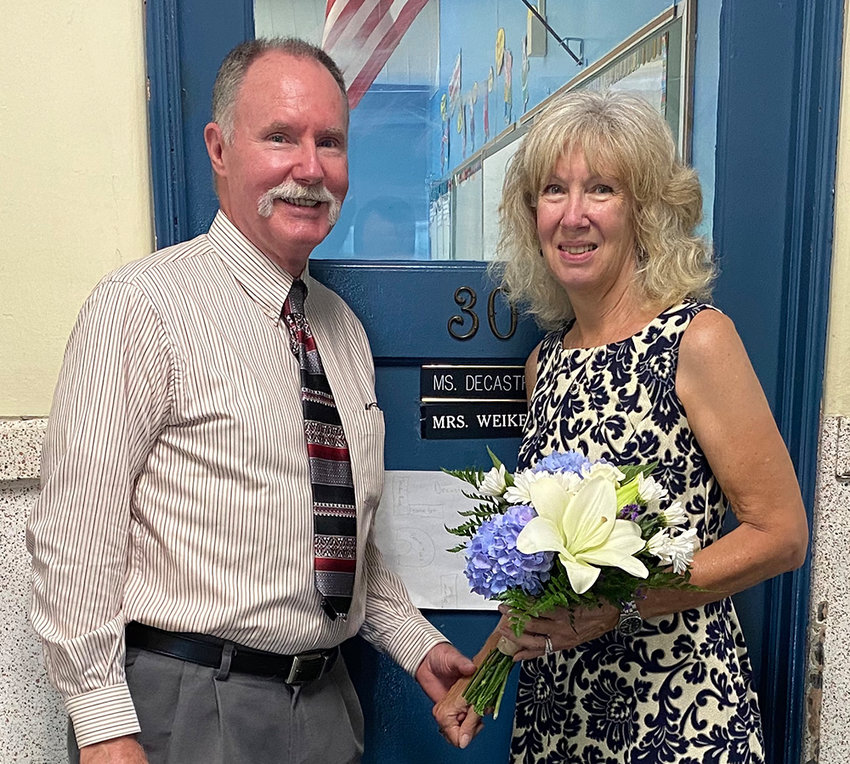 Dan Moore (left) and Diane Crist-Moore (right) were married in room 30 at Walden Elementary School last Tuesday. The two met there in fifth grade during the 1966-1967 school year.