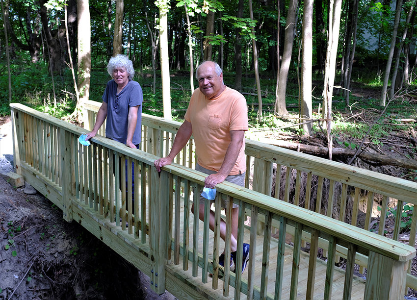 Tony Falco [l.] and Councilman Howard Baker stand on the new footbridge at the Marlboro Nature Trail.