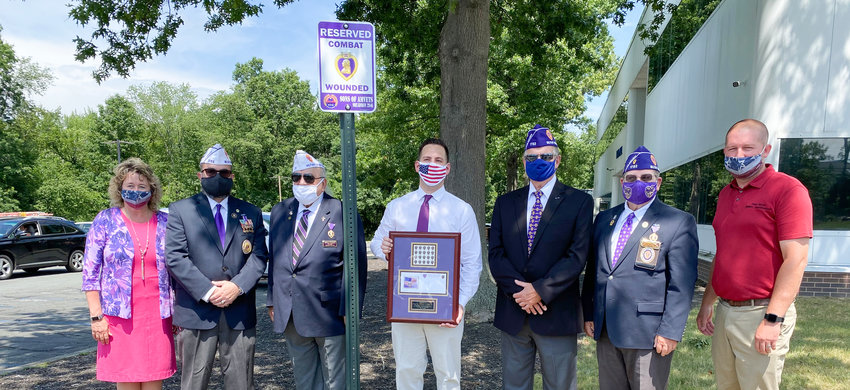 Town of Montgomery officials stand with local members of the Military Order of the Purple Heart at the new parking spot at town hall that is dedicated to Purple Heart recipients. From left to right: Town Clerk Tara Stickles, Past Commander of the Department of New York Richard Gerbeth Jr., Department of New York Commander William Nazario, Town Supervisor Brian Maher, Veterans of Foreign Wars Commander Post 2064 John Luffman, Chapter 1782 Commander Richard Drago and Highway Superintendent Shaun Meres.