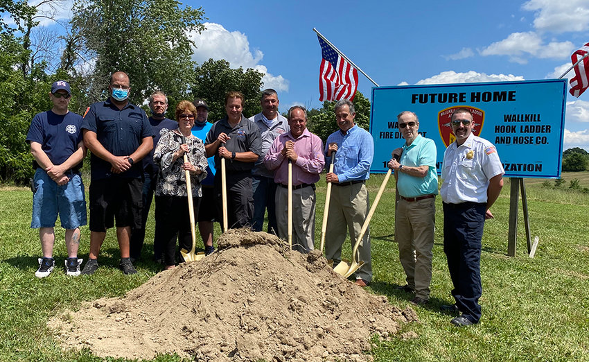 Officers and volunteers from the Wallkill Hook, Ladder and Hose Company break ground at the site of their new firehouse across the street from John G. Borden Middle School. From left to right: Lieutenant Jason Thorn, Captain Michael May, Volunteer Firefighter Robert Cromie, Commissioner Anne Barnhart, Volunteer Firefighter Todd Post, Commissioner Craig Ross, Past Chief Joseph LoCicero, Commissioner Michael Croce, Commissioner Andy Harcher, Commissioner Archie Reed and Chief Nick Walker.