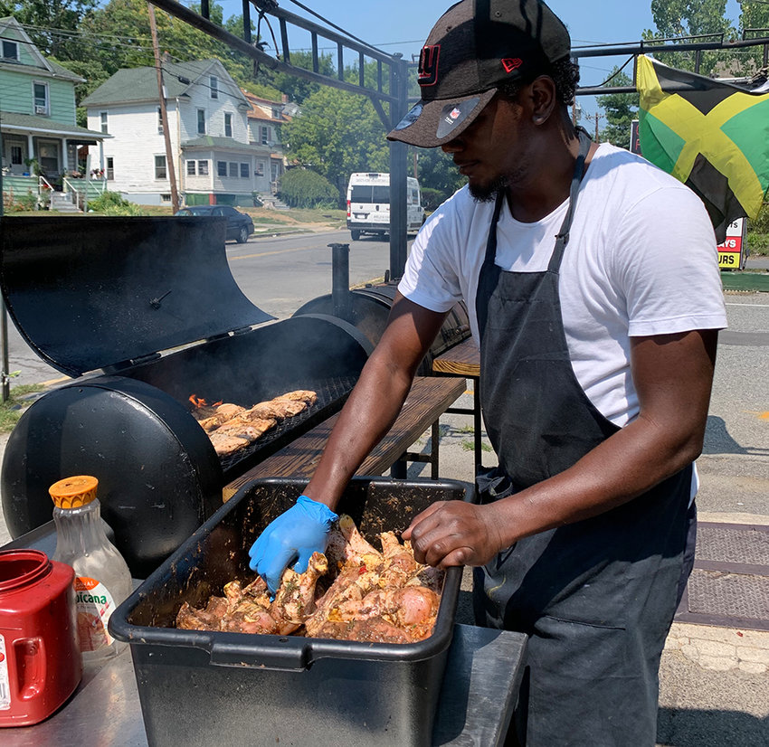 Rainy Brown prepares jerk chicken for the lunchtime rush.