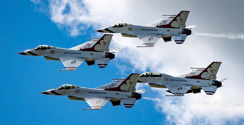 Air Force Thunderbirds flying in formation over Orange County Airport Sunday.