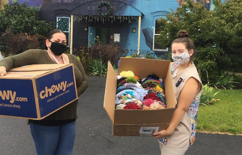 "Recently, Emma Greiner [R], an Ambassador Girl Scout of Apple Valley Troop 60050 in Marlboro, made 100 knit hats as part of her ""Hundred Hats for the Homeless"" Take Action project. Emma purchased much of the yarn herself, but gratefully received donations from a few members of the community. The Darmstadt Shelter in Kingston was pleased to receive the donation for the community members they serve."