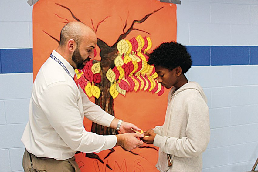 Circleville Middle School Assistant Principal Seth Siegel works with a student during Unity Day.