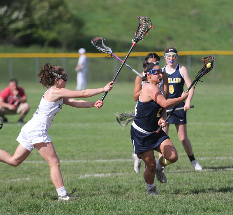 The Highland girls' lacrosse team in action in 2019. The COVID-19 pandemic shut down the spring 2020 season. The 2021 season will be squeezed in after fall sports are played in March and April.