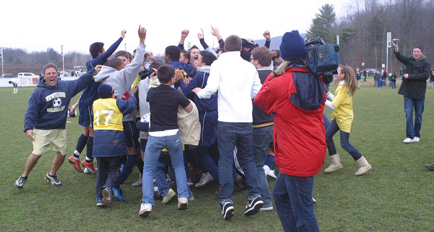 NFA Boys Soccer Coach Matt Iorlano (far left) celebrated a state championship in 2009. He will have to wait until March to find out  if  his current team can measure up to the past.