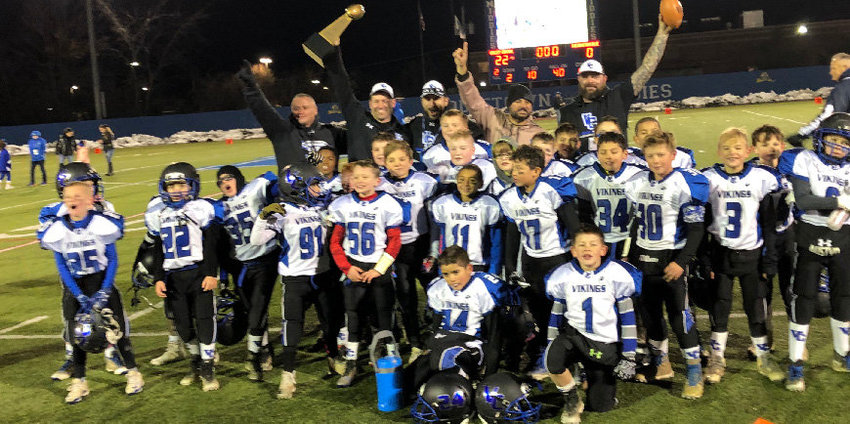 A Valley Central youth football team celebrates a championship in 2018.