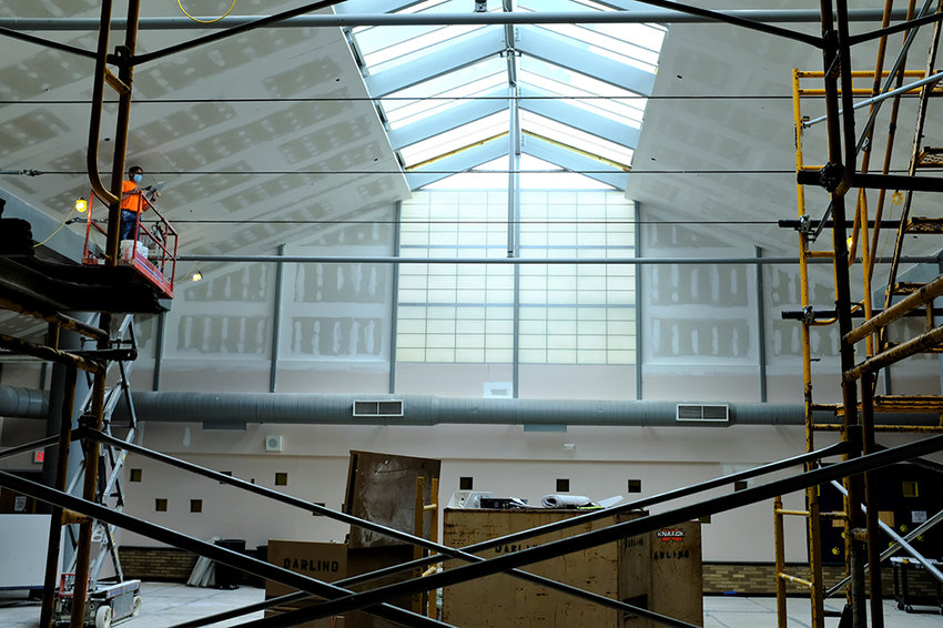 The High School Library is being finished with a new skylight, painted walls and LED light fixtures.