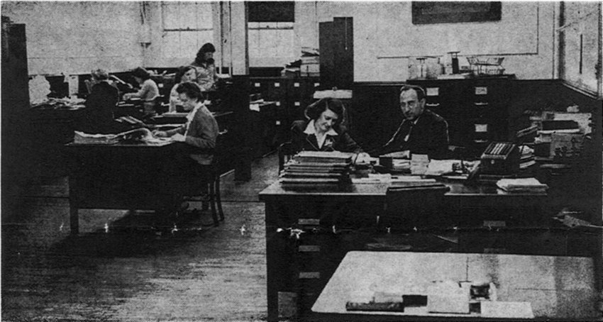 Part of the extensive business office of The News is shown in this view of office personnel at their desks. At extreme right is· H. V. Nocton, chief auditor, who is in charge of this office. All supplies for the entire plant are ordered by this department, and all accounts are kept here.