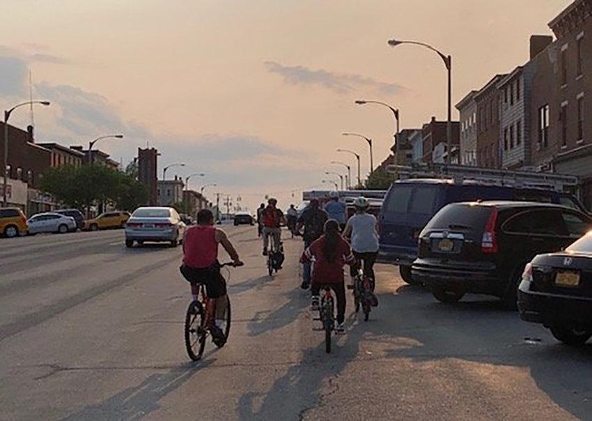 Cyclists make their way down Broadway