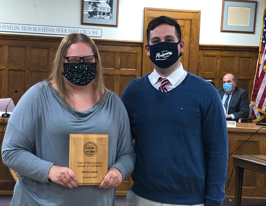 Sonia Lewis (left) stands with Montgomery Town Supervisor Brian Maher (right) after receiving her citizen of the month award.