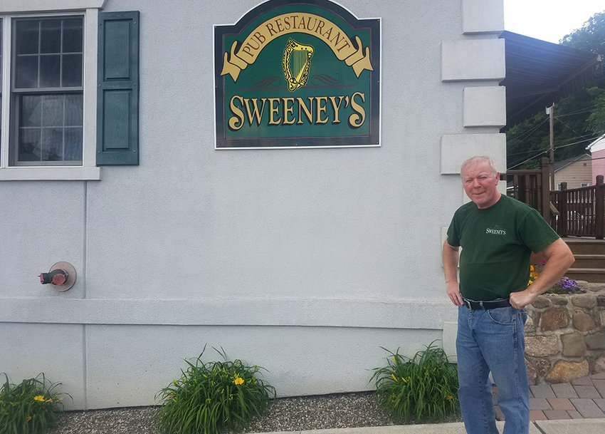 Sweeney's Irish Pub owner Gary Sweeney stands in front of his restaurant. The pub remains open during the COVID-19 pandemic, which has forced many restaurants to close.