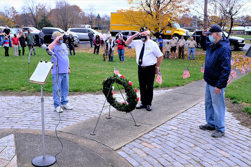 After the wreath was laid, a salute was given by veterans Tom Schroeder, of the American Legion [c.], Jack Lynn [l.] and John Gallagher [r.].