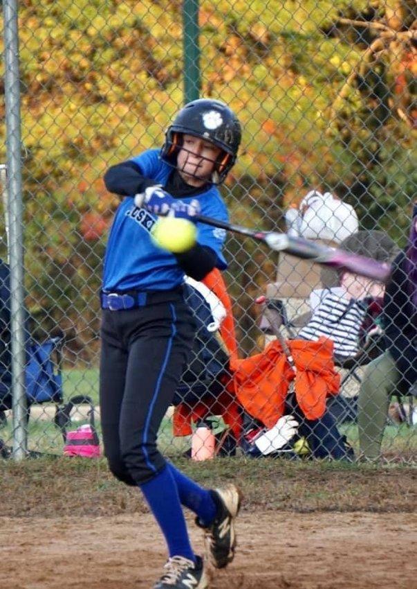 Kalista Birkenstock, the daughter of James T. Birkenstock, hits for the Empire State Huskies 14U National softball team.