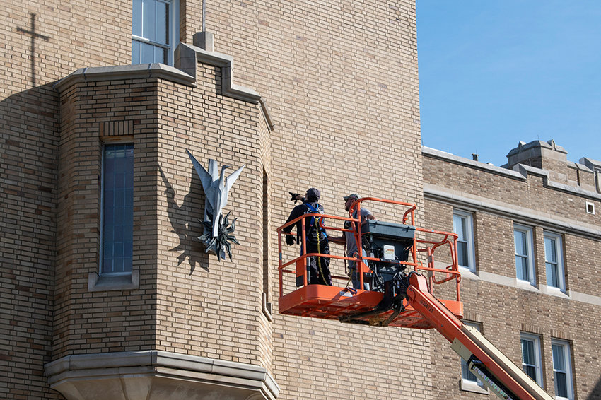 Mount Saint Mary College's installs  the phoenix sculpture that previously hung outside of Curtin Library on the side of the Dominican Center on Thursday, November 5, 2020.