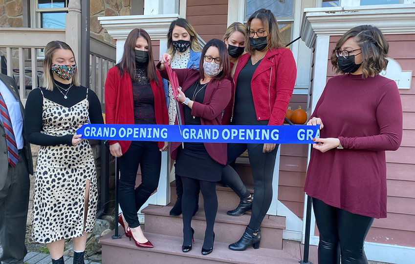 La Pêche owner Kate Bradatsch cuts the ribbon during a ceremony at her new location on Saturday. Her business recently moved from 201 Ward Street to 13 Union Street in the Village of Montgomery.