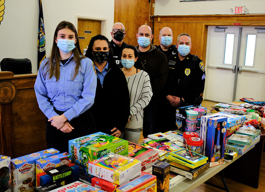 Participants in this year's Marlborough Police Toy Drive included [l - r] dispatcher Georgie Super, Jennifer VanAmburgh, Tina Rosa and officers Curt Fulton, Mike Sotanski, Gerard Biviano and Sgt. Chris Griggs.