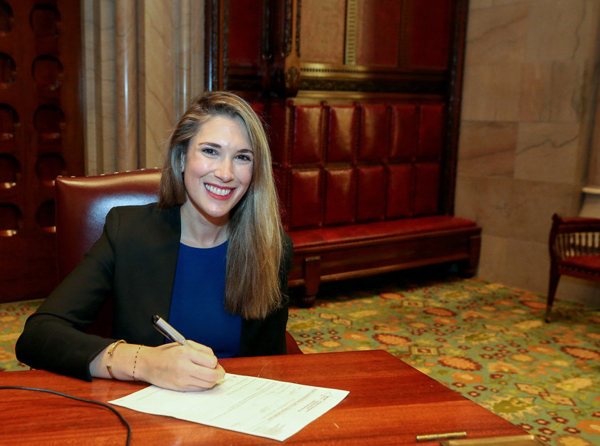 Senator Michelle Hinchey (SD-46) signs her Oath of Office in Albany.