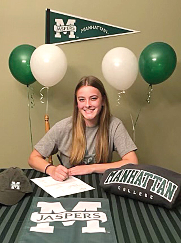 Valley Central senior Madeline Feller signs her National Letter of Intent to play Division I soccer at Manhattan College.