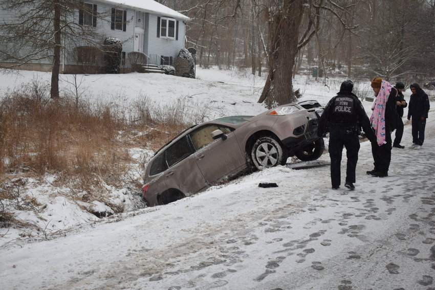 Two vehicles  ended up in a ditch, Tuesday afternoon following an accident on snow-covered Rock Cut Road