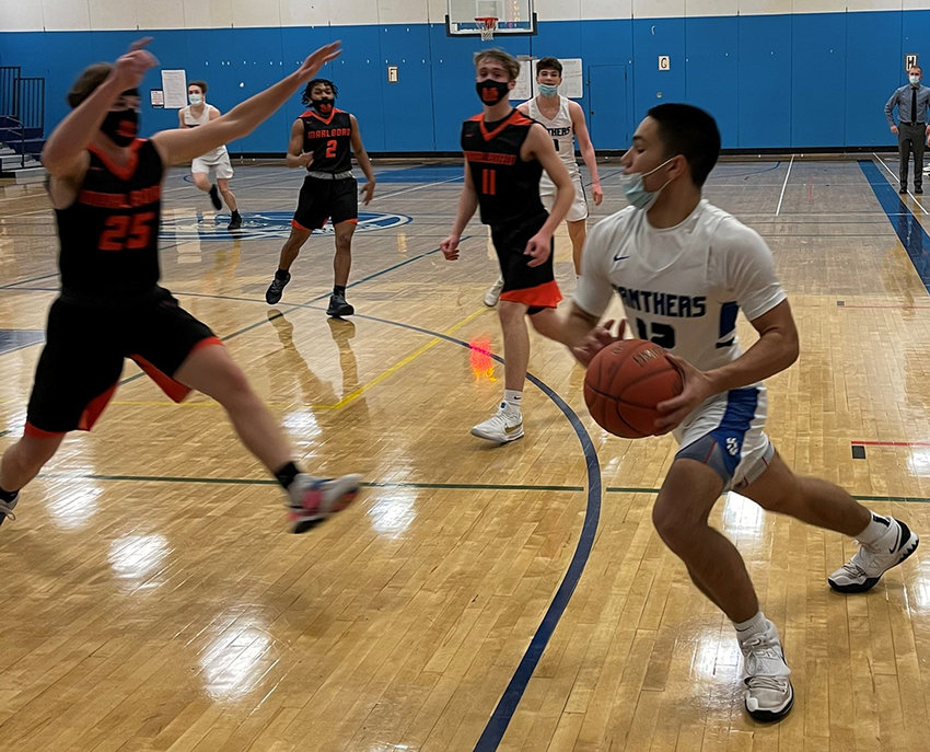 Wallkill's Jeremy Figueroa drives to the hoop during Wednesday's boys' basketball game at Wallkill High School.