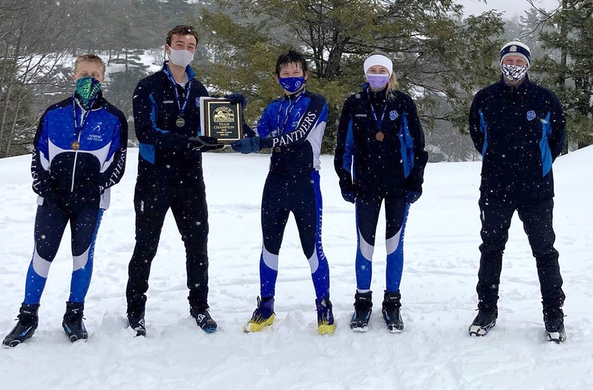 Members of the Wallkill Nordic Ski team pose with the Section 9 championship plaque on Feb. 23 at Minnewaska State Park.